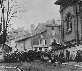 Soldiers of the 353rd Infantry near a church at Stenay, Meuse in France, wait for the end of hostilities.  This photo was taken at 10:58 a.m., on November 11, 1918, two minutes before the armistice ending World War I went into effect.